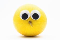 Żółty melon z googly oczami na białym tle Obrazy Royalty Free