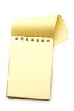 Żółty pusty notepad z otwartą stroną Obrazy Royalty Free