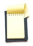 Żółty pusty notepad z otwartą stroną Obraz Stock
