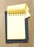 Żółty pusty notepad z otwartą stroną Zdjęcie Stock