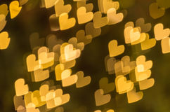 Żółty serca bokeh tło Zdjęcia Royalty Free