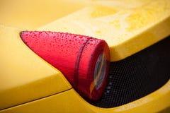 Żółty sportowego samochodu ogonu światło z podeszczowymi kroplami Obraz Royalty Free