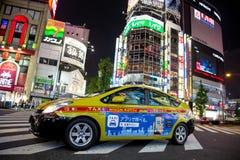 Żółty taxicab w Tokio Zdjęcia Royalty Free