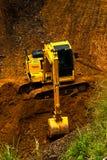 Żółty typ ładowacza ekskawatoru earthmoving maszynowy robi wor Zdjęcie Royalty Free