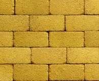 Żółty złoty ściana z cegieł obrazy royalty free