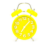 Żółty budzik na bielu Zdjęcia Stock
