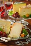 Żółty ser i wino fotografia stock