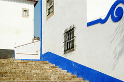 Óbidos stairs. Detail of a pitoresque wall painted in white and blue at the center of the old medieval town of Óbidos, Portugal Royalty Free Stock Images