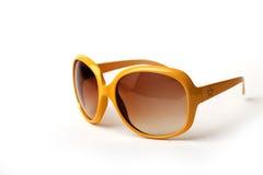 Óculos de sol amarelos em um fundo branco Imagens de Stock Royalty Free