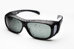 Óculos de sol com gotas de água Fotografia de Stock