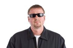 Óculos de sol desgastando do tipo duro Fotografia de Stock Royalty Free