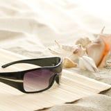 Óculos de sol na praia Imagens de Stock Royalty Free
