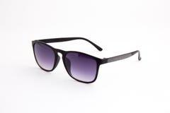 Óculos de sol pretos em um fundo branco Imagem de Stock Royalty Free