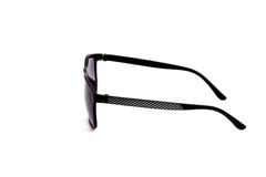 Óculos de sol pretos em um fundo branco Fotos de Stock
