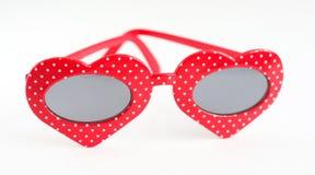 Óculos de sol sob a forma dos corações Fotografia de Stock Royalty Free