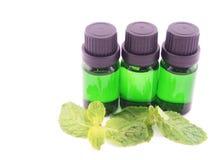 Óleo do aroma no fundo branco Fotografia de Stock