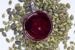 Óleo e sementes de semente da abóbora Fotos de Stock Royalty Free