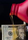 Óleo para o dinheiro Imagem de Stock Royalty Free