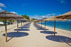 Ö av Vir strandparaplyer Royaltyfri Fotografi