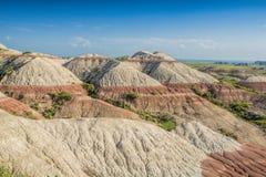 Ödländer mit roten gestreiften Hügeln Stockfoto