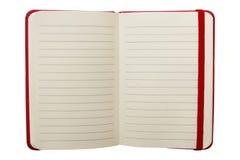 Öffnen Sie das Notizbuch, das auf weißem Hintergrund getrennt wird Stockbilder