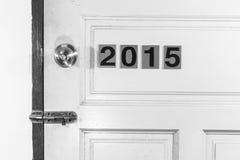Öffnen Sie die alte Tür 2014 zum neuen Leben im Jahre 2015 Lizenzfreies Stockfoto