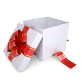 Öffnen Sie die weiße Geschenkbox, die mit einem roten Farbband verziert wird Stockfoto