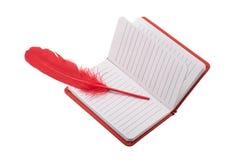 Öffnen Sie freier Raum gezeichnetes Notizbuch mit roter Feder Stockfoto