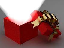 Öffnen Sie Geschenkkasten mit einem Strahl der Leuchte. Stockfoto