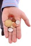 Öffnen Sie Hand mit Münzen Lizenzfreie Stockfotos