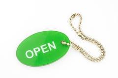 Öffnen Sie sich im grünen Aufkleber Lizenzfreies Stockfoto