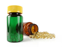 Öffnen Sie und schließen Sie Vitaminflaschen Stockfotografie