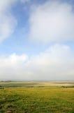 Öffnen Sie weit Felder und Himmel Stockfotos