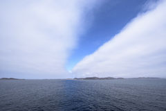 Öffnungswolken Stockbild