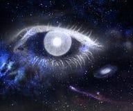 Öga och universum. Arkivfoto