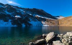 Ögat - det djupast av de is- sjöarna, Rila berg, Bulga Royaltyfria Bilder