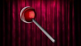Öglan roterar den röda klubban på gardinetappen arkivfilmer