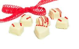 Öglasband, choklader, valentin dag Royaltyfri Bild