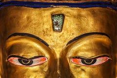 Ögon av det Maitreya Buddhaslutet upp Arkivfoto