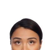 Ögon av en asiatisk kvinna som ser upp royaltyfria bilder
