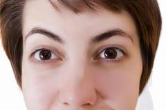 Ögon av en ung kvinna royaltyfria foton
