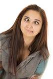 Ögon för uttryck för mörkt hår för kvinna korsade nära royaltyfria foton