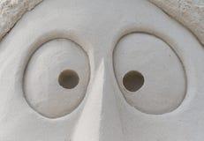 Ögon i sand arkivbilder