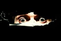 ögon man läskigt Arkivbild