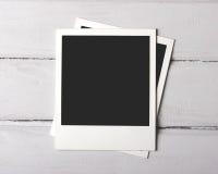 Ögonblickliga foto på vita plankor Arkivfoton