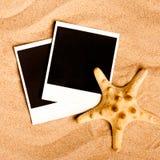 Ögonblickliga fotoramar på stranden Arkivbild