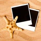 Ögonblickliga fotoramar på stranden Arkivfoto