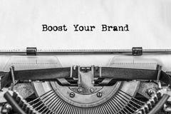 Öka din märkestext skrivas inte av en tappning royaltyfri bild
