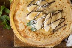Öken - bunt av pannkakan med bananen Arkivfoton