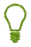 Ökologische Glühlampeikone vom grünen Gras Stockfotos